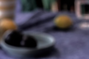 Stillleben mit Pflaumen und Zitronen